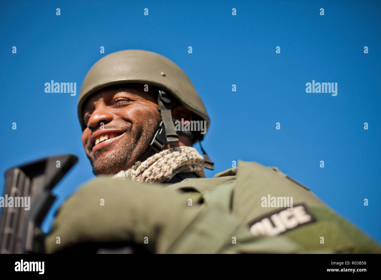 Male police officer at a training facility. - Stock Image