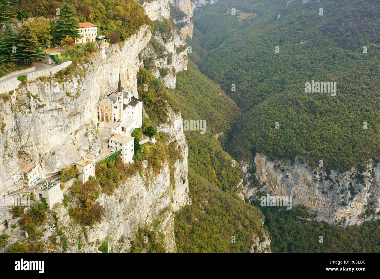 SANCTUARY ON A LEDGE ON A CLIFF FACE (aerial view from a 6-meter mast). Sanctuary of Madonna della Corona. Spiazzi, Province of Verona, Veneto, Italy. - Stock Image