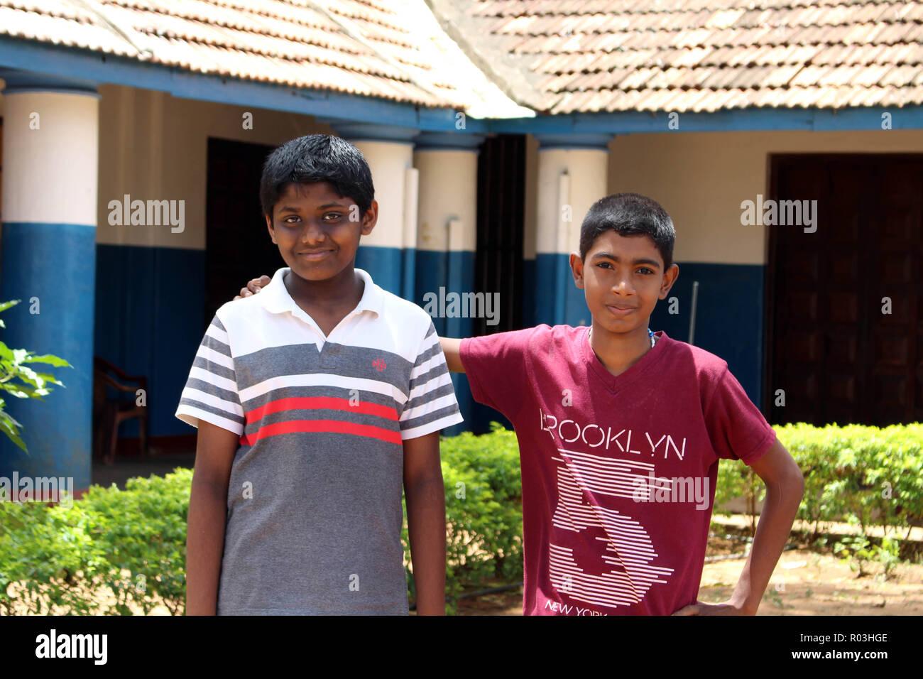 Friendship of Srilankan Sinhalese boys in Trincomalee. Taken in Srilanka, August 2018. Stock Photo