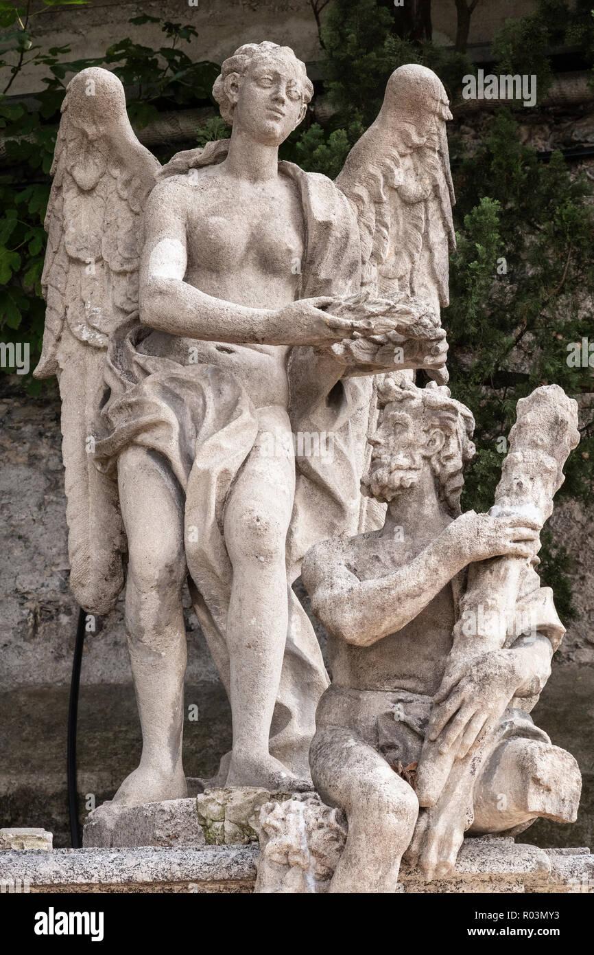 Statue in the gardens of Villa Monastero at Varenna on Lake Como, Italy Stock Photo