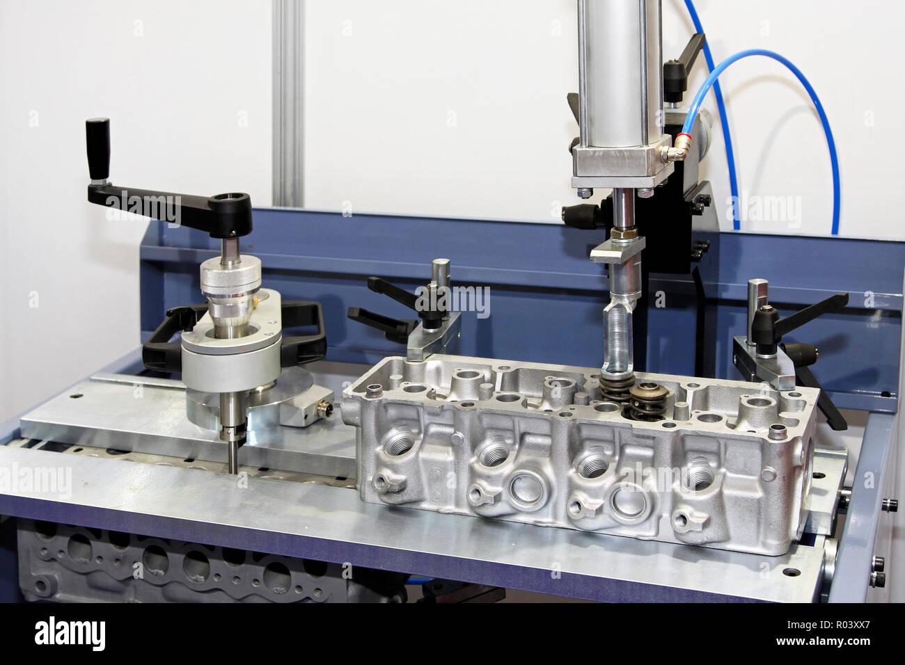 Aluminum engine head at auto repair garage Stock Photo