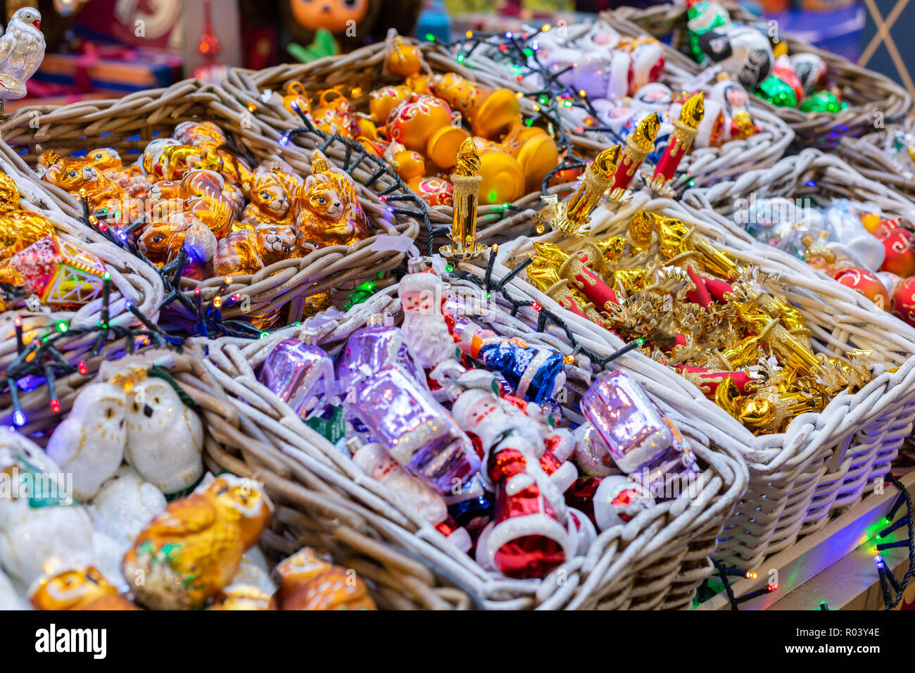 Various decorations and souvenirs on christmas market. Xmas fair. Festive Holiday. Christmas market, fair. Close up. - Stock Image