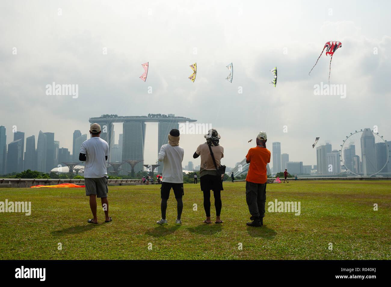 Singapore, Republic of Singapore, flying kites - Stock Image
