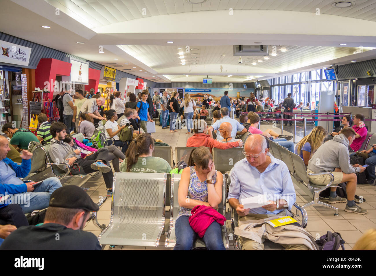 airline passengers waiting for boarding, windhoek airport, Namibia - Stock Image