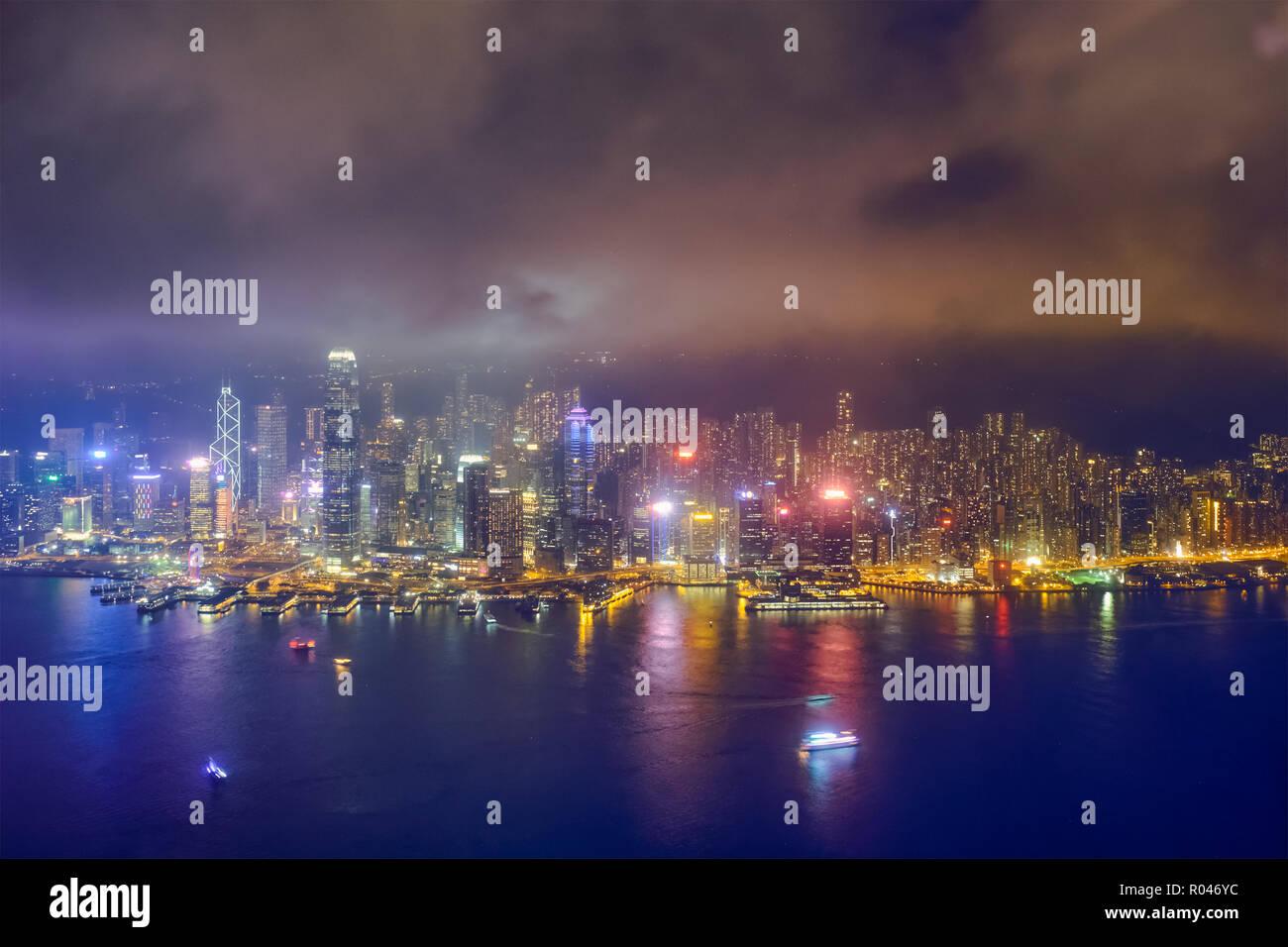 Aerial view of illuminated Hong Kong skyline. Hong Kong, China - Stock Image