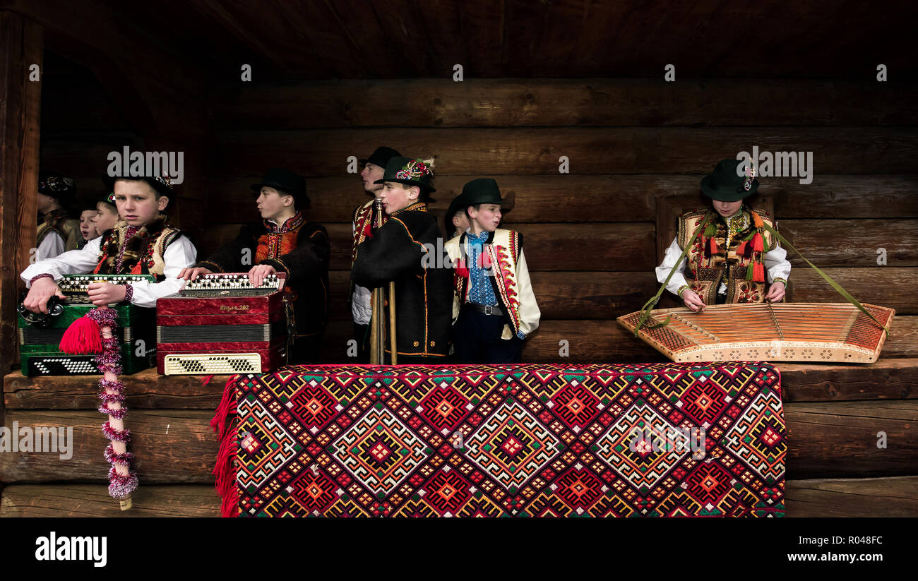 Uzhgorod, Ukraine - Jan 13, 2018: Vasylya festival celebrating in Museum of Folk Architecture and Life. Hutsul kids from Rakhiv region prepare for per - Stock Image