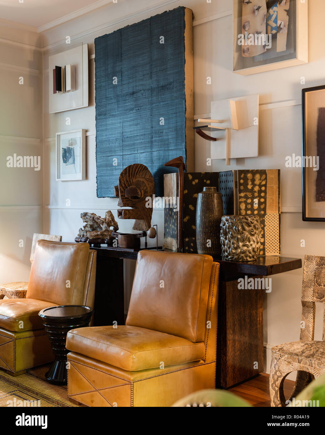 Eclectic living room with leather chairs Stock Photo