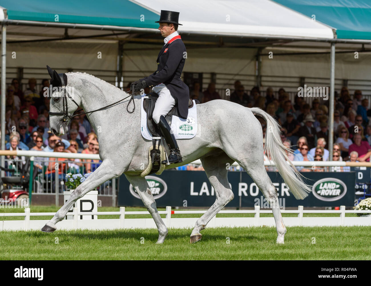 Harry Meade and AWAY CRUISING during the dressage phase of the Land Rover Burghley Horse Trials, 2018 Stock Photo