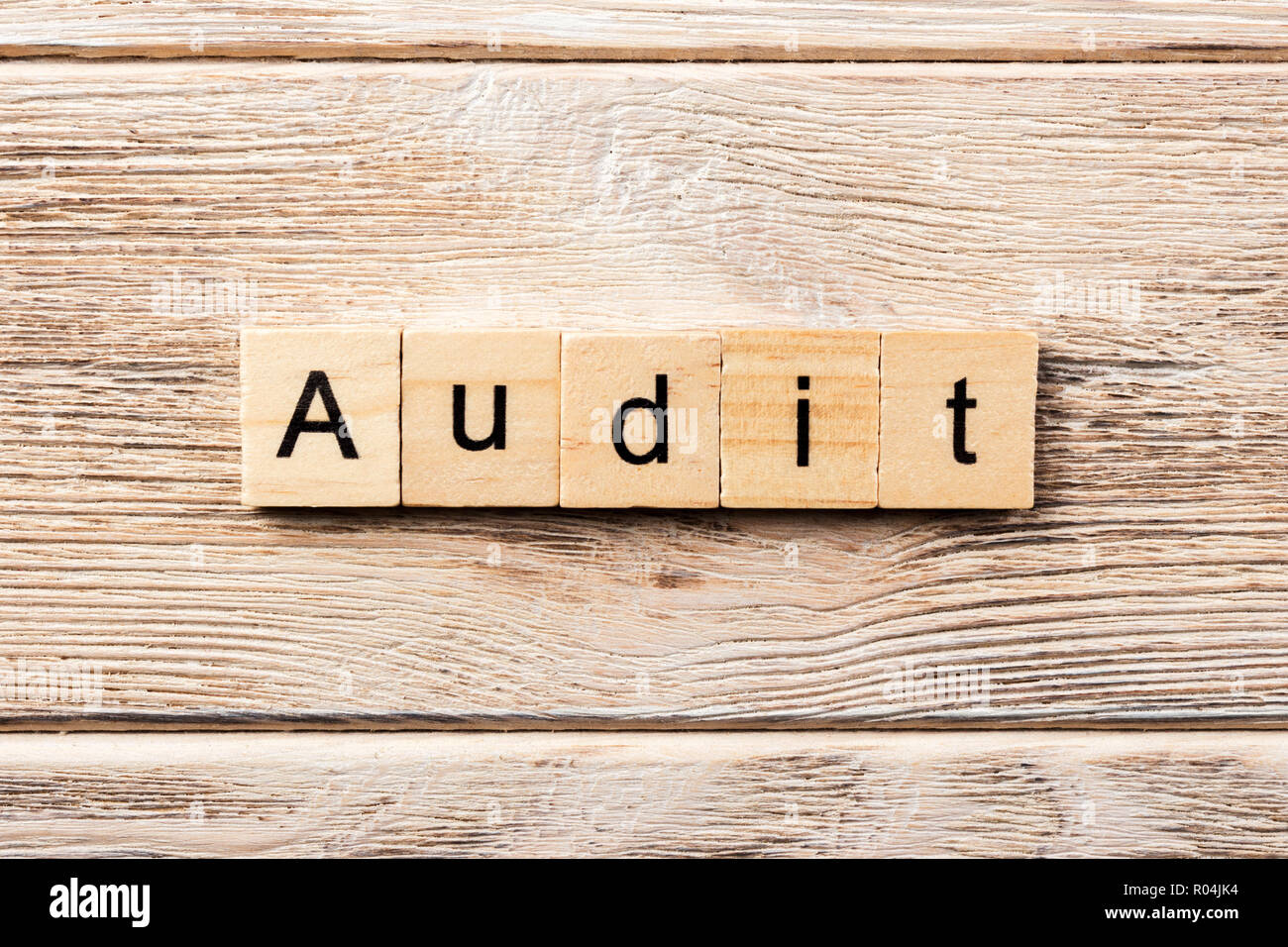 audit word written on wood block. audit text on table, concept. - Stock Image