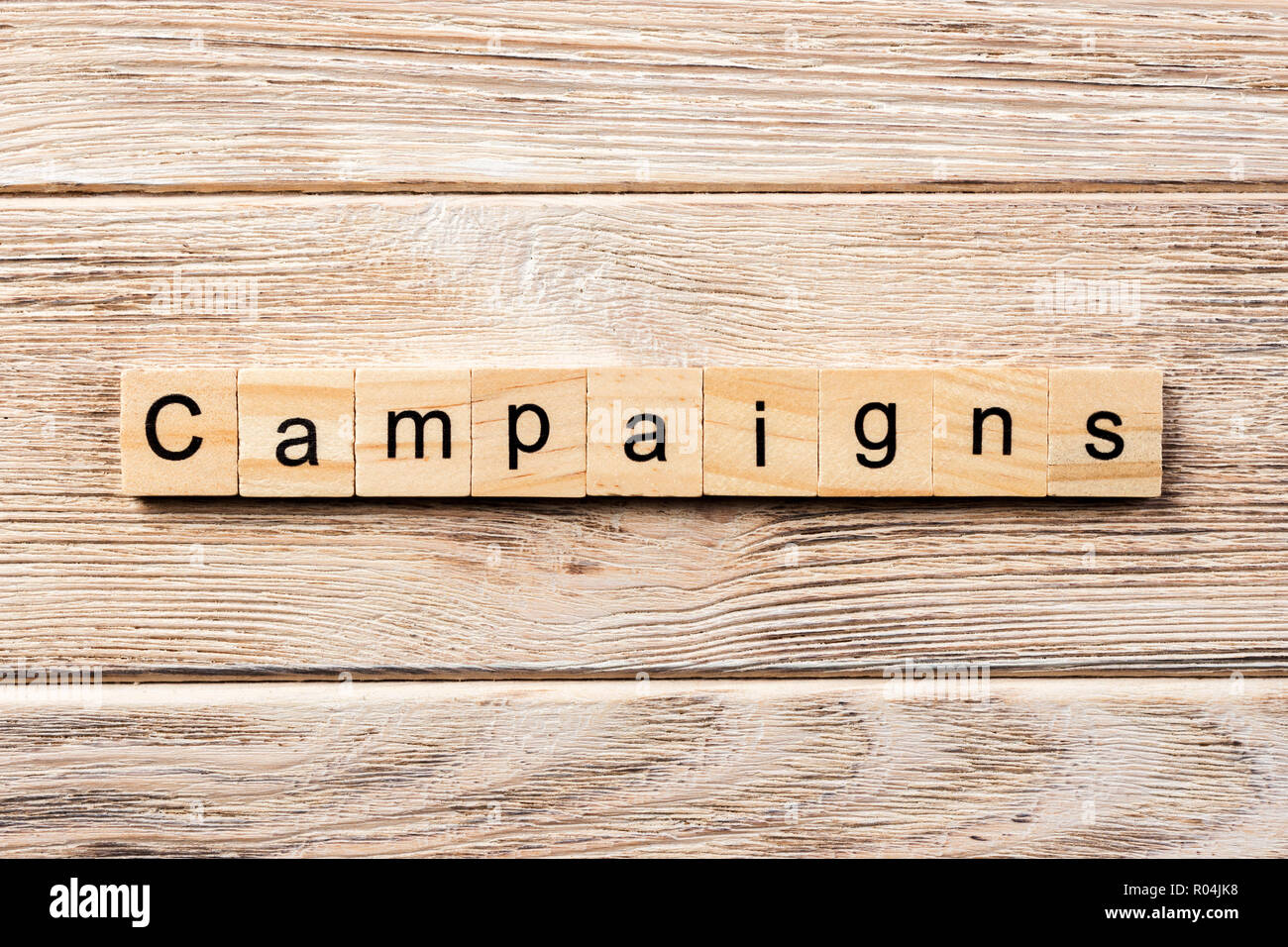 campaign word written on wood block. campaign text on table, concept. - Stock Image