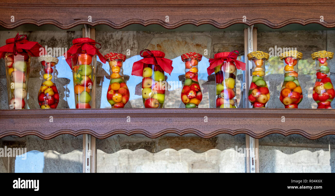 Glass Decorative Jars With Colorful Lids Filled With Various Fruits