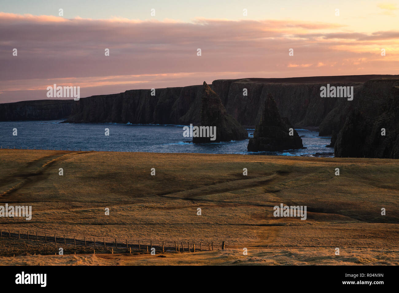 Amazing rock formations called Duncansby Stacks - northern Scotland, John o'Groats area, summer evening trip. - Stock Image