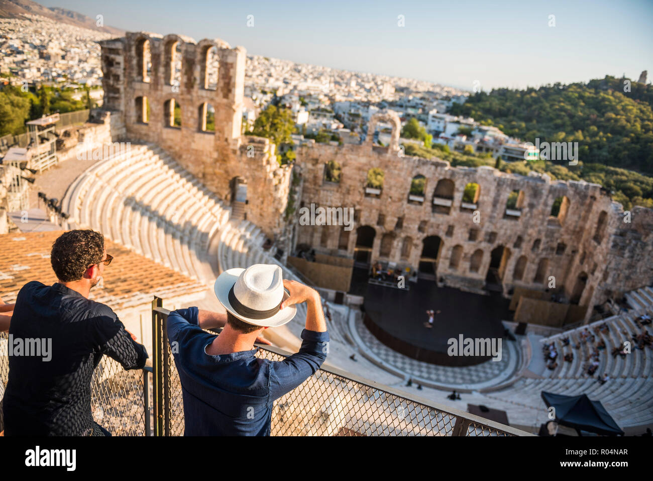 Tourists at Odeon of Herodes Atticus Theatre, by the Acropolis, UNESCO World Heritage Site, Athens, Attica Region, Greece, Europe - Stock Image