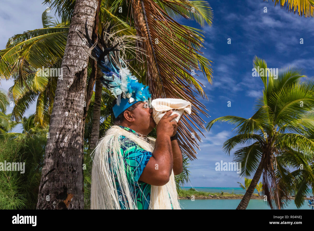 A conch shell blowing warrior welcoming guests to Aitutaki, Cook Islands, South Pacific Islands, Pacific - Stock Image