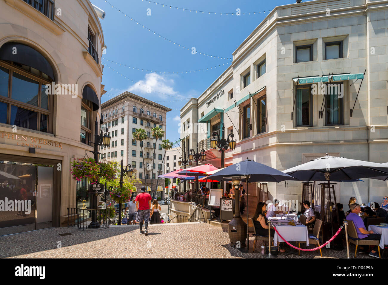 View of shops on Rodeo Drive and Beverley Wilshire Hotel, Beverly Hills, Los Angeles, California, United States of America, North America - Stock Image