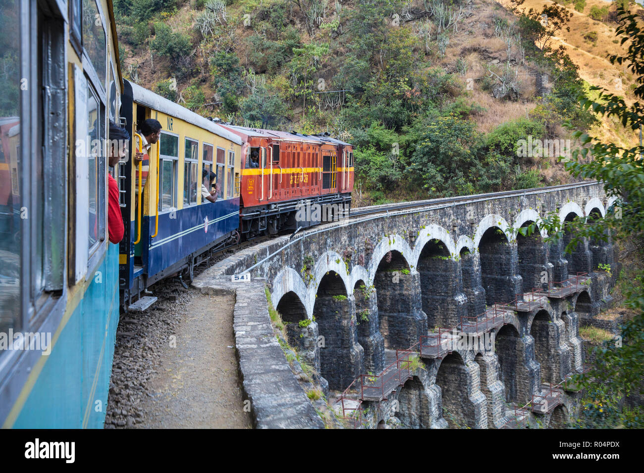 The Himalayan Queen toy train crossing a viaduct, on the Kalka to Shimla Railway, UNESCO World Heritage Site, Northwest India, Asia - Stock Image