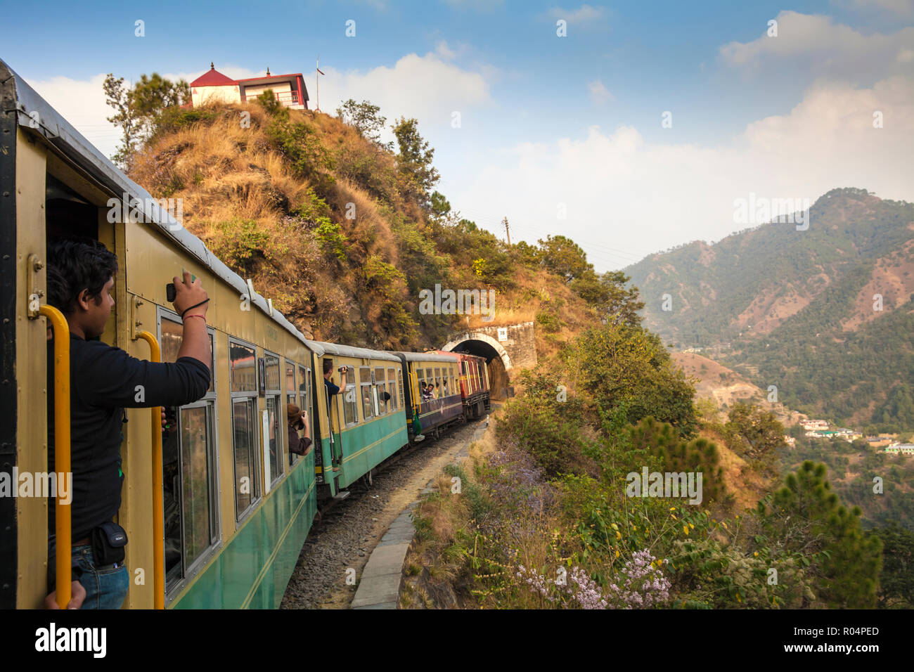 The Himalayan Queen toy train approaching a tunnel, on the Kalka to Shimla Railway, UNESCO World Heritage Site, Northwest India, Asia - Stock Image
