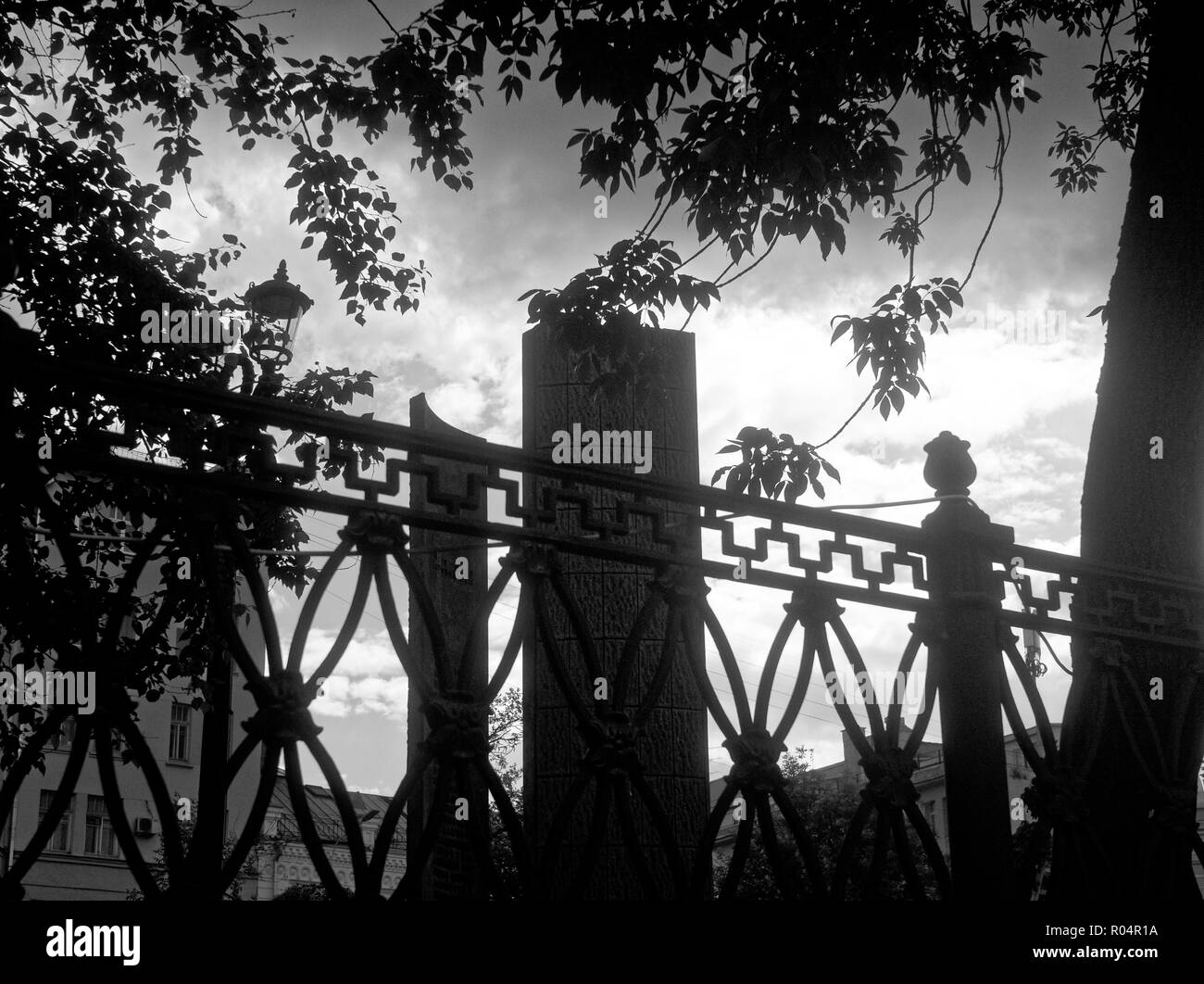 openwork fence in the Park in Moscow, black and white photo - Stock Image