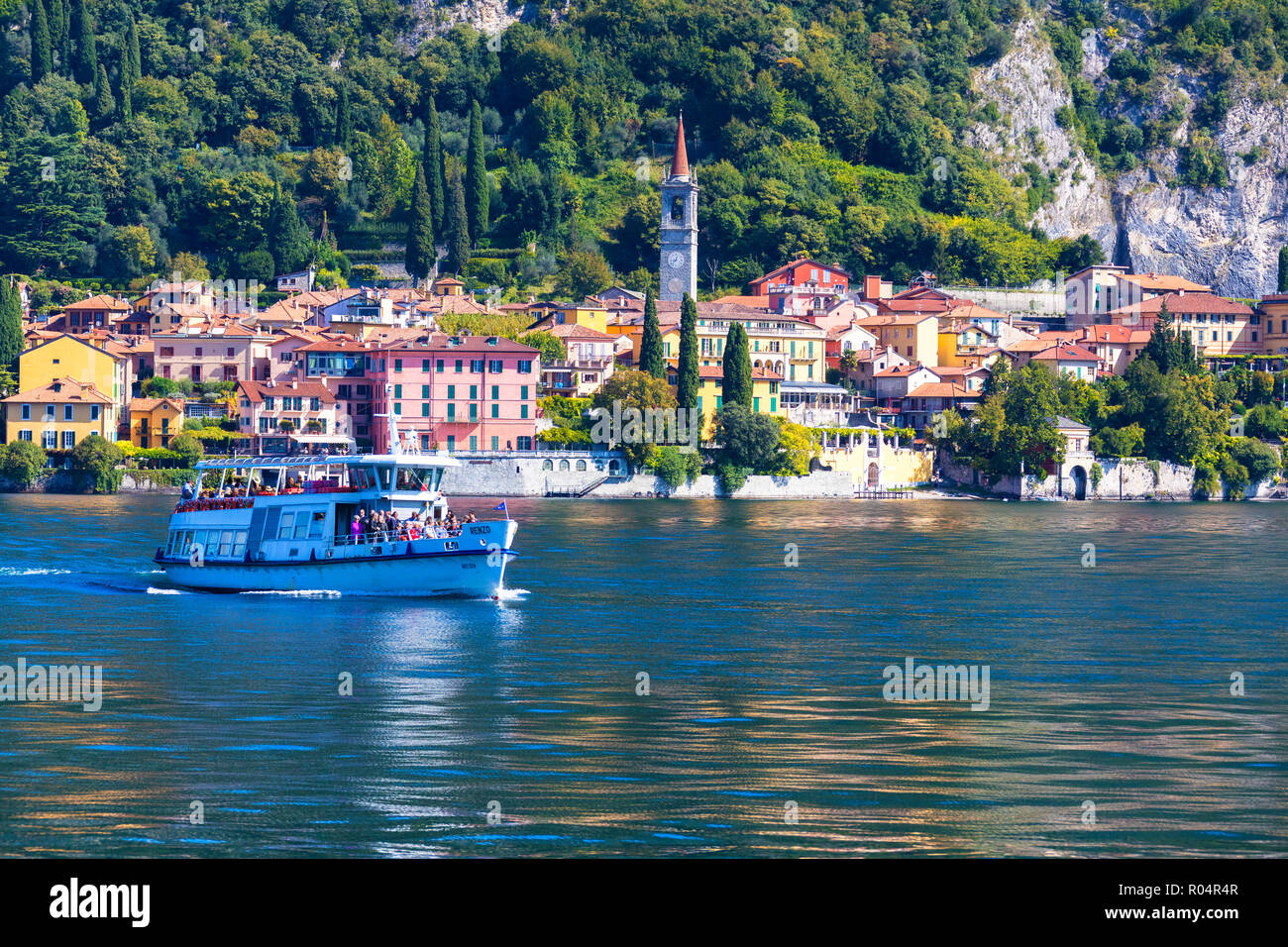 People on boat trip around the village of Varenna, Lake Como, Lecco province, Lombardy, Italian Lakes, Italy, Europe Stock Photo