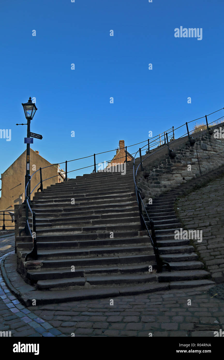 199 Steps, Church Lane, Whitby, North Yorkshire, England, UK leading up to St Mary's Church. Pictured on a bright autumn day with blue cloudless sky. - Stock Image
