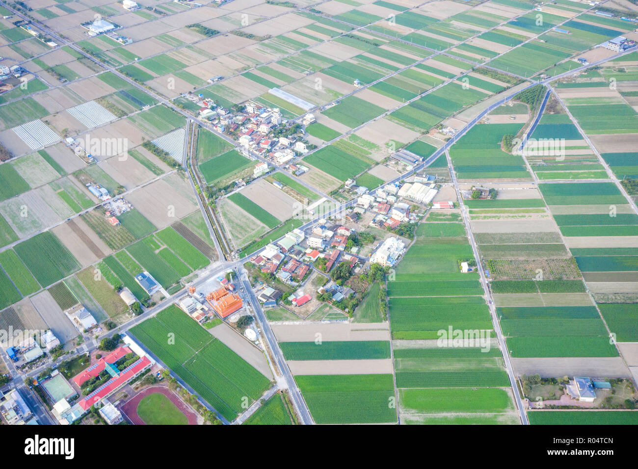 Fields with various types of agriculture and villages beside with
