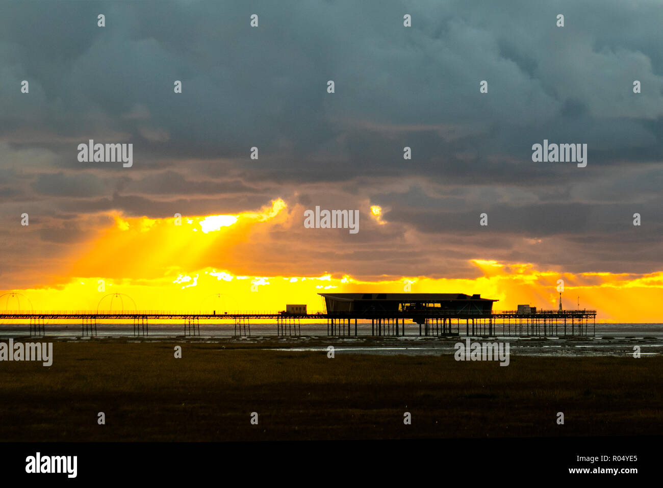 Southport, Merseyside. 1st Nov 2018.Heavy showers, cumulonimbus clouds, and turbulent skies at sunset. Storm clouds gather over the coastal resort pier and beach. Credit; MediaWorldImages/AlamyLiveNews - Stock Image