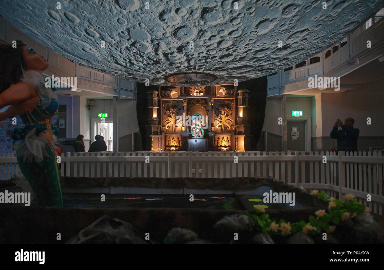 Leicester, UK. 1 November 2018. Museum of the Moon Rangoli Diwali Exhibition at Belgrave Neighbourhood Centre featuring Luke Jerram's 7 metre diameter model moon. - Stock Image