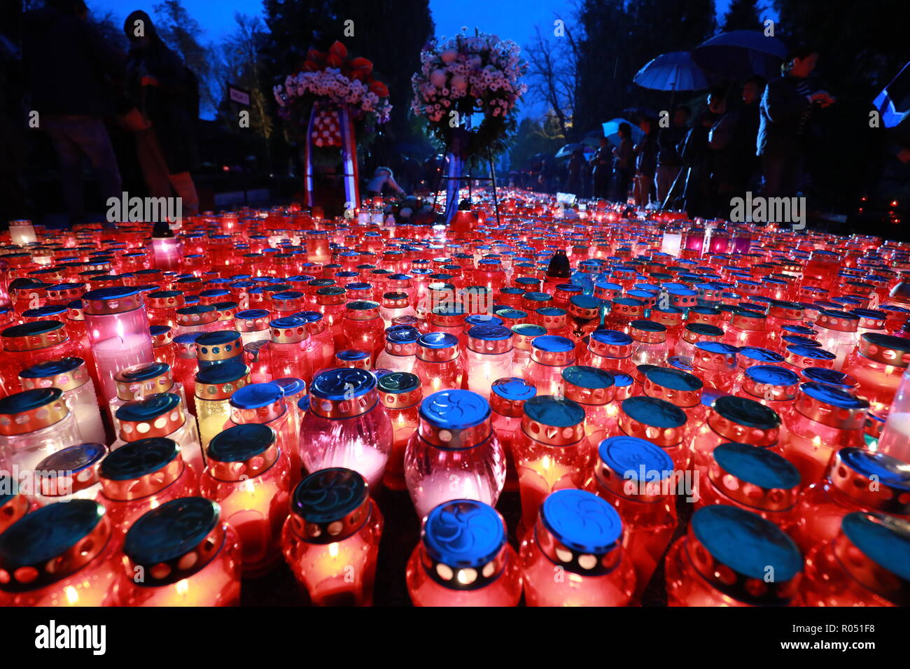 Zagreb, Croatia. 1st Nov, 2018. Candles are lit for the deceased at Mirogoj Cemetery in Zagreb, Croatia, on Nov. 1, 2018. Croatian people gathered at cemeteries around the country to honor their late relatives, commemorating All Saints' Day. Credit: Sanjin Strukic/Xinhua/Alamy Live News - Stock Image