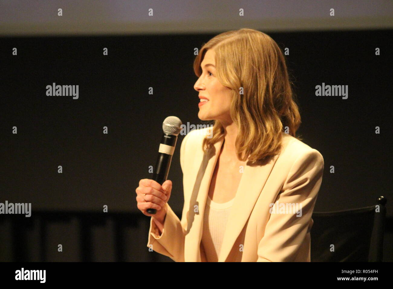 New York, USA. 1st November, 2018. Actor Rosamund Pike speaks after a screening of her film 'A Private War' about war correspondent Marie Colvin.  Photo: Matthew Russell Lee / Inner City Press Credit: Matthew Russell Lee/Alamy Live News - Stock Image