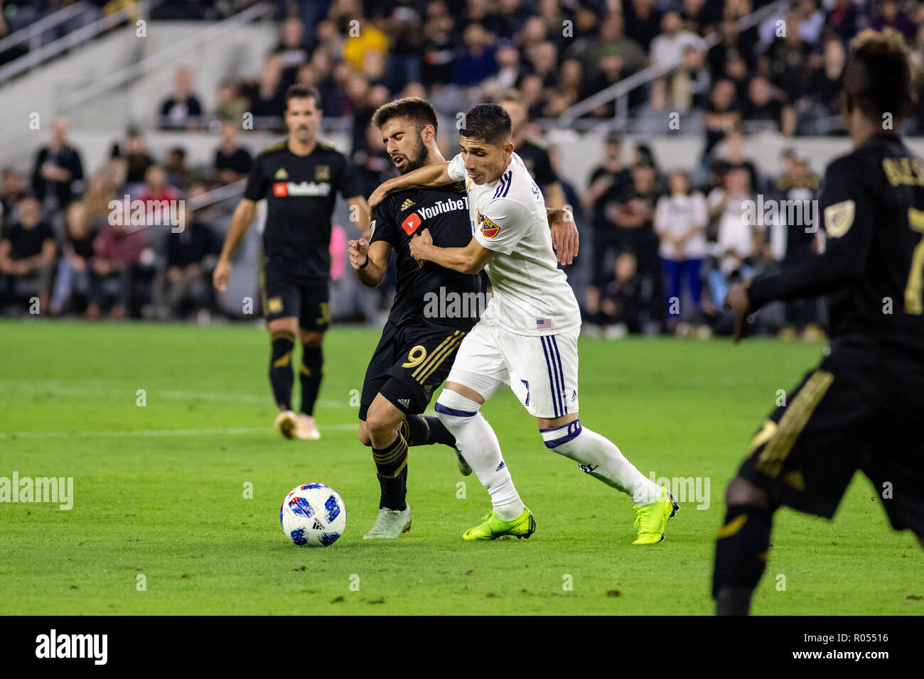 Los Angeles, USA. 1st November 2018. Real Salt Lake's Jefferson Savarino (7) stiff arms LAFC's Diego Rossi (9) off the ball during the first half of their playoff match. Credit: Ben Nichols/Alamy Live News - Stock Image