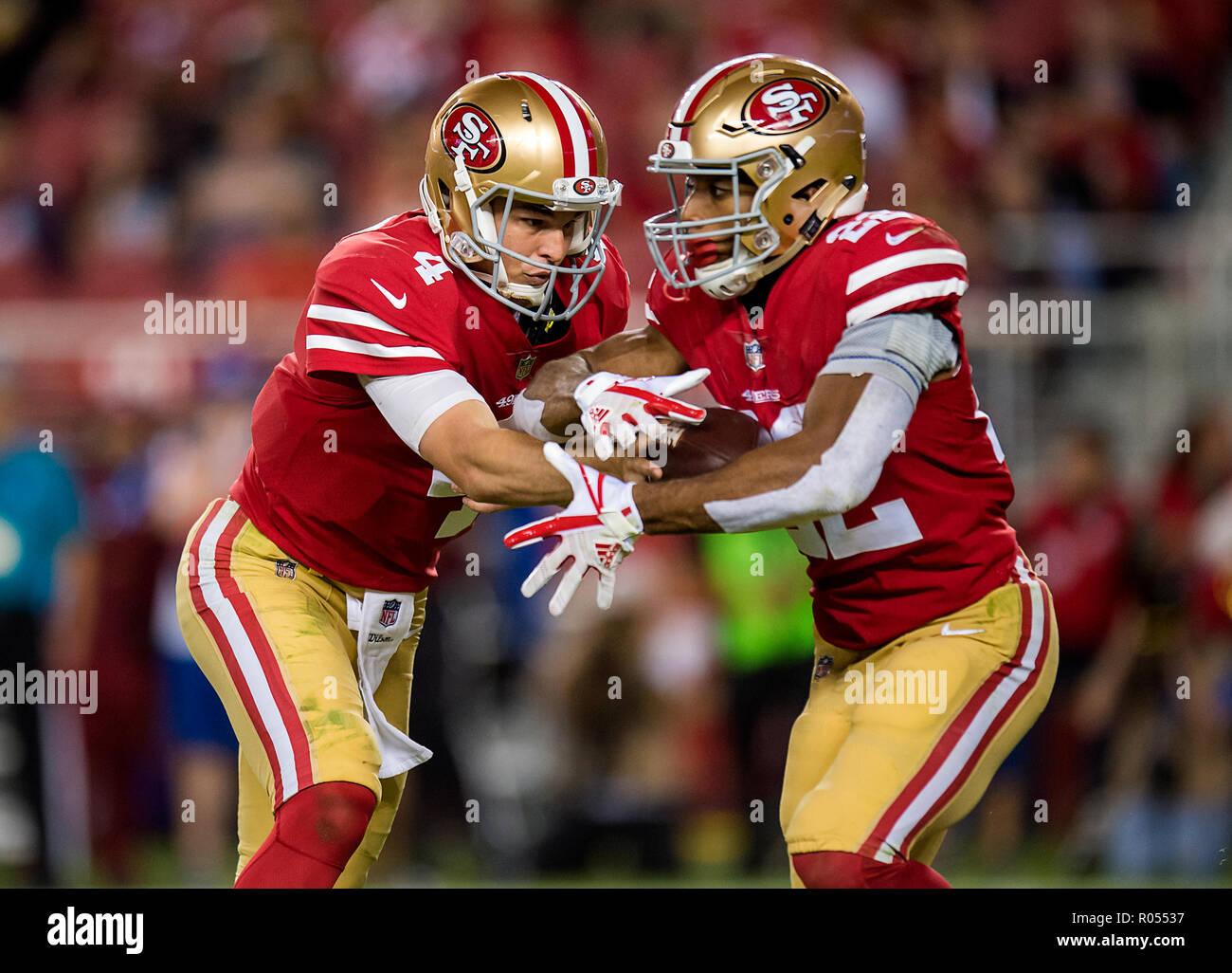 2ffdbcbe4 San Francisco 49ers quarterback Nick Mullens (4) hands off to San Francisco  49ers running back Matt Breida (22) in the second quarter during a game ...