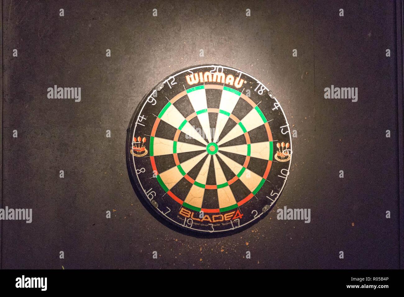 Darts board in a pub game - Stock Image
