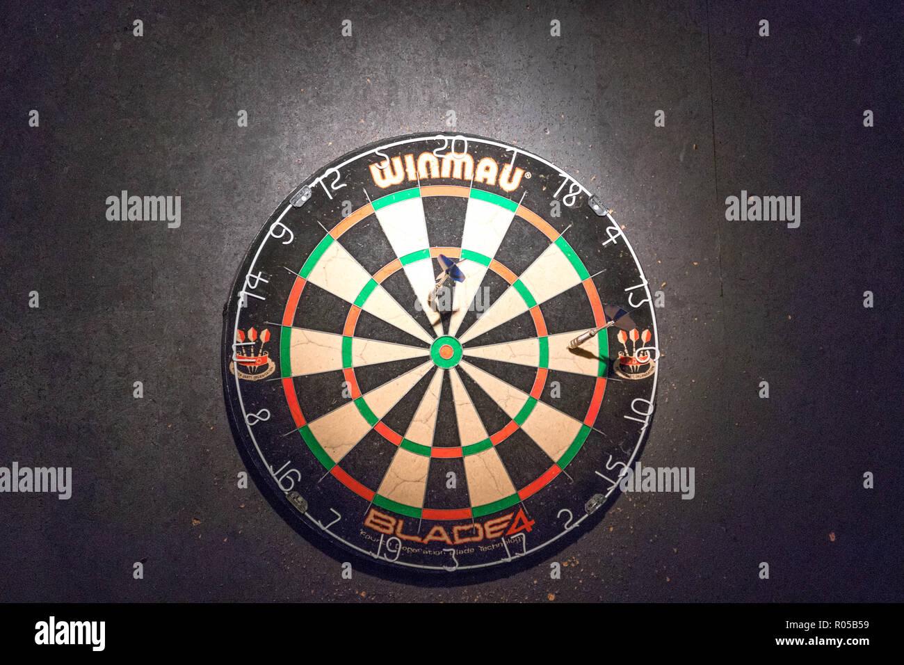 Darts board in a pub game Stock Photo