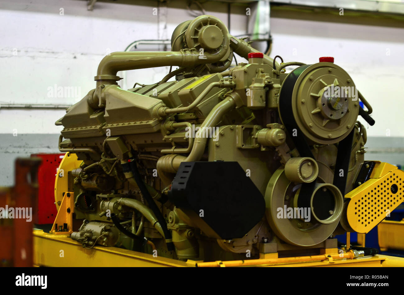 Large diesel engine with a huge turbine in the warehouse of
