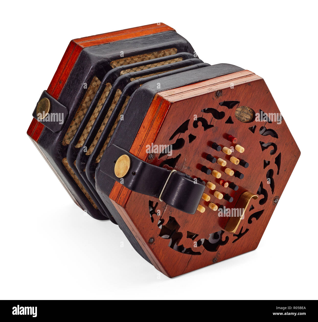 A restored 19th century English Lachenal & Co bone buttoned concertina on a white background - Stock Image