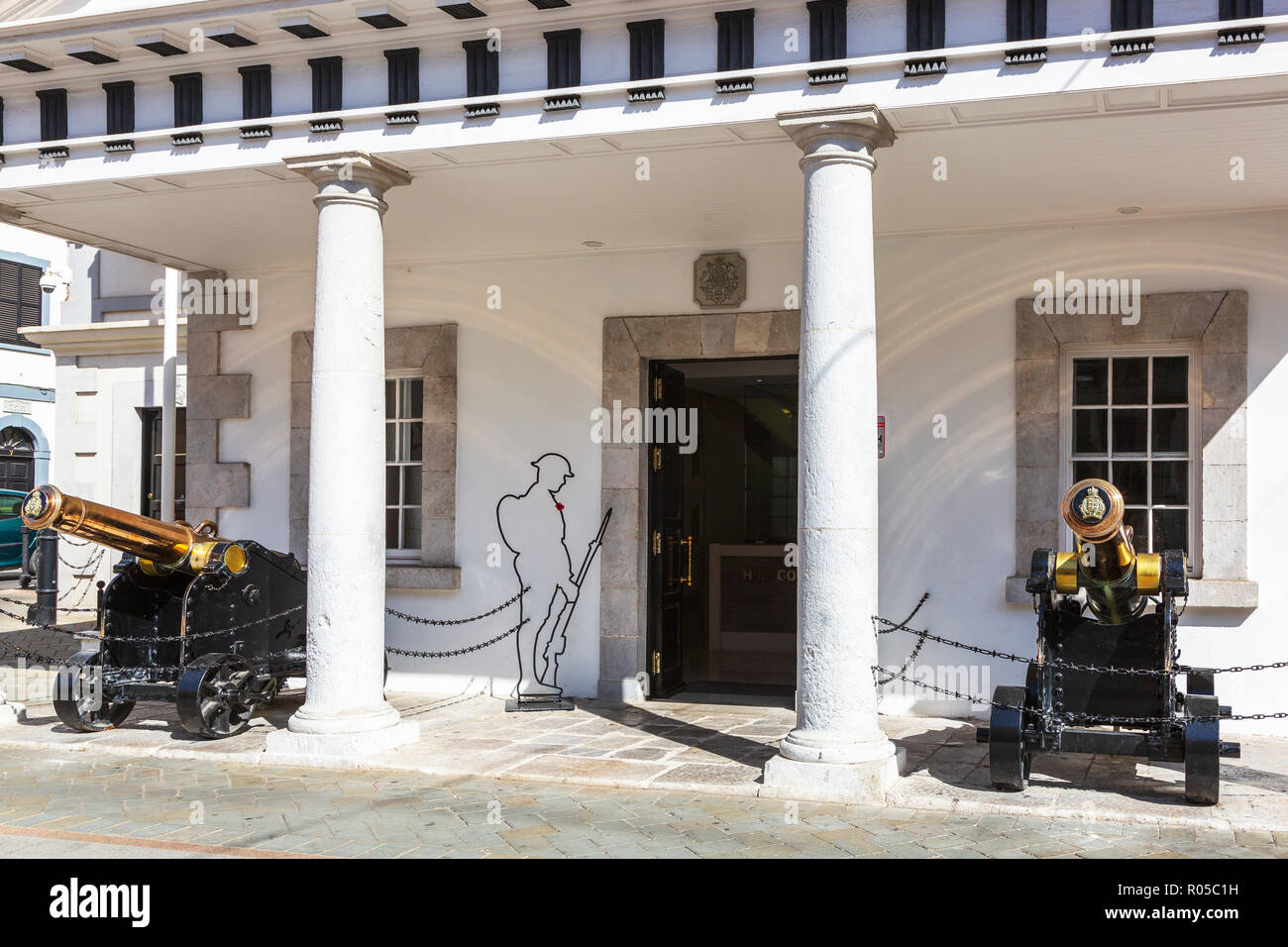 Gibraltar Government building on Main street, decorated with two cannons, Gibraltar, British Overseas Territory - Stock Image