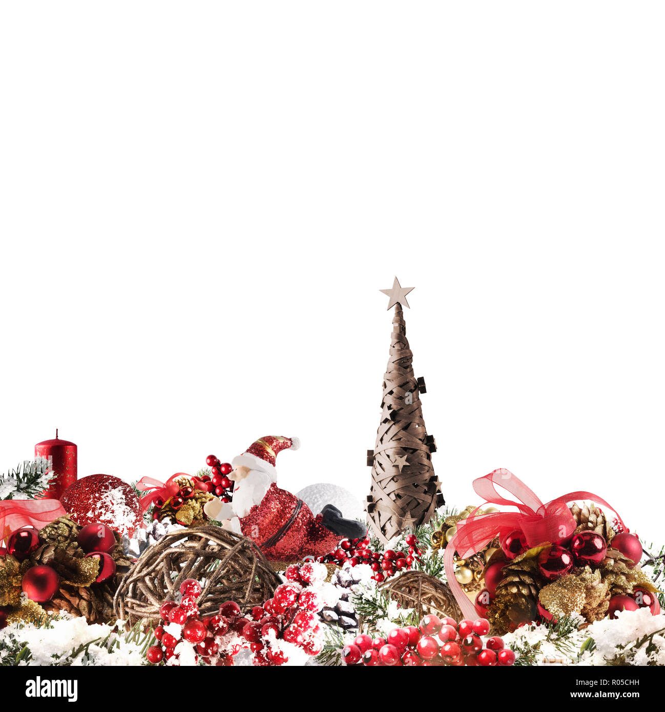 Christmas background concept. Shimmering Christmas decorations with tree, Santa Claus and candles - Stock Image