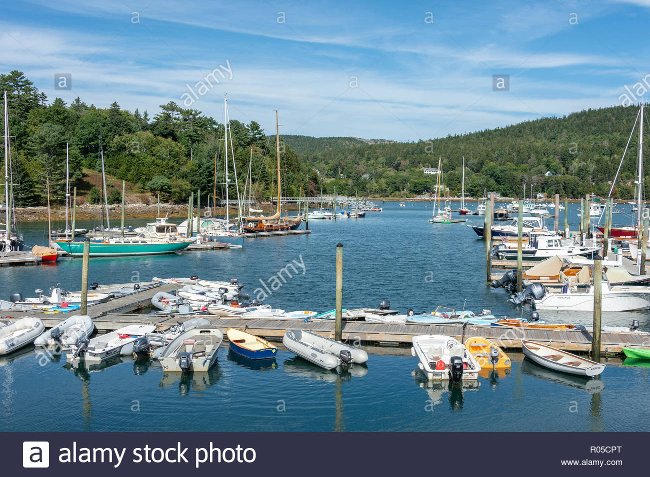 Northeast Harbor, Maine, USA - September 22, 2018: Boats moored in every direction in Northeast Harbor on last day of summer - Stock Image