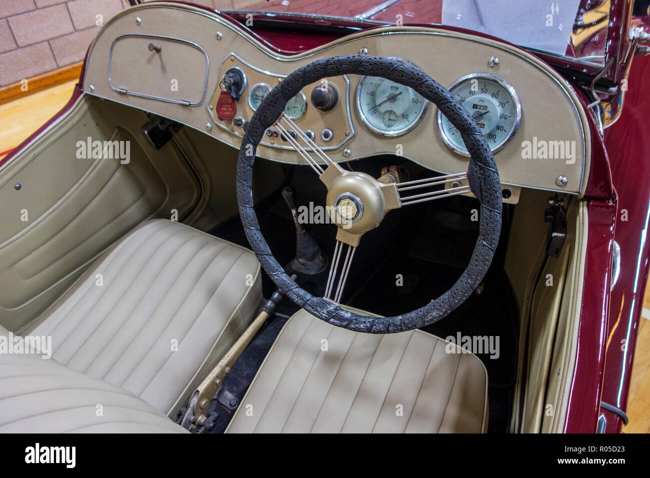 Steering wheel and dashboard of a classic British MG TD 1953 sports car - Stock Image