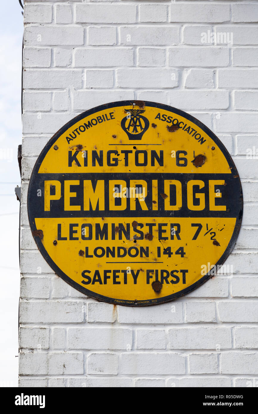 old black and yellow aa wall sign detailing mileage from pembridge