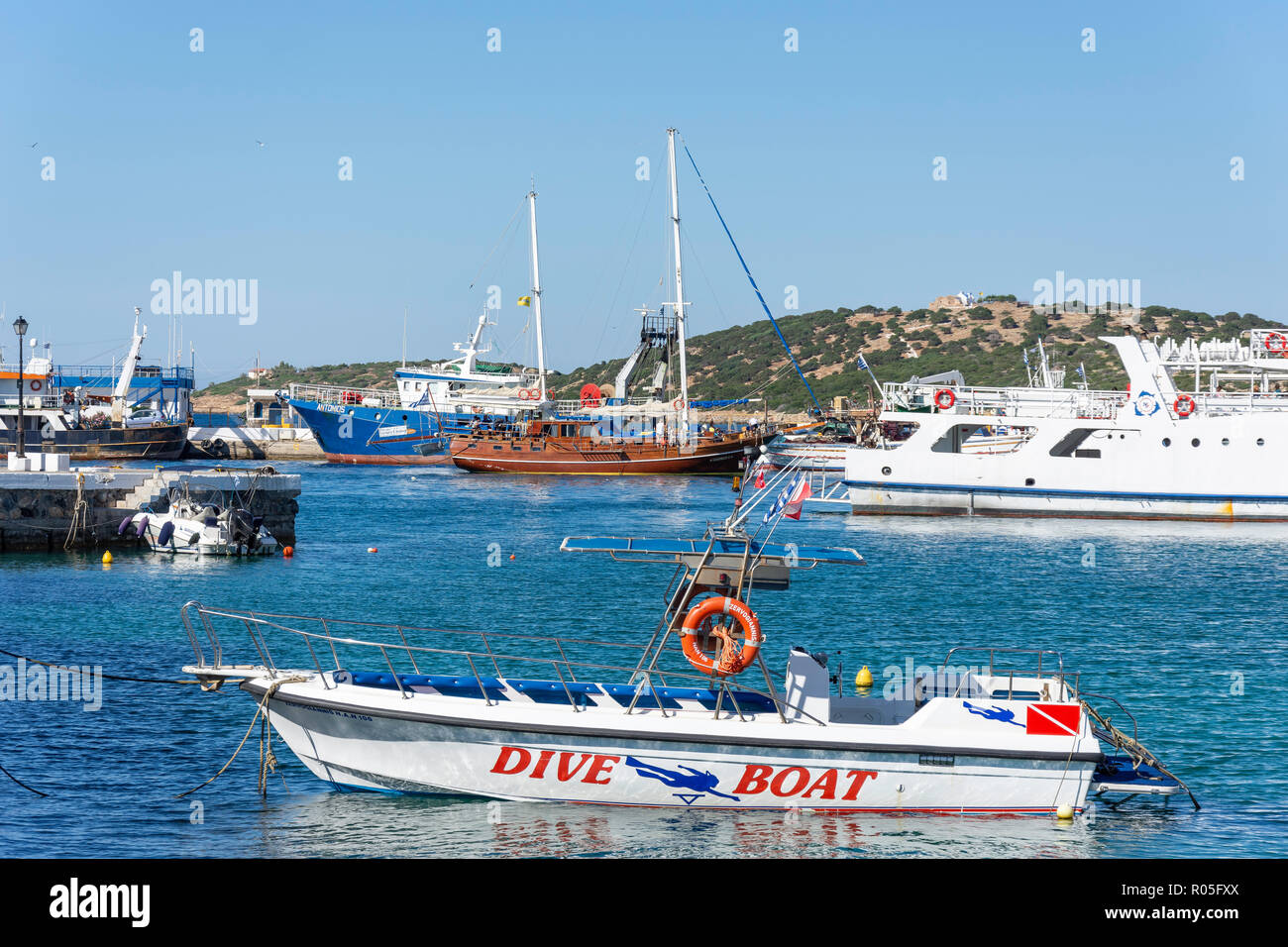 Excursion and dive boats in harbour, Agios Nikolaos, Lasithi Region, Crete (Kriti), Greece - Stock Image