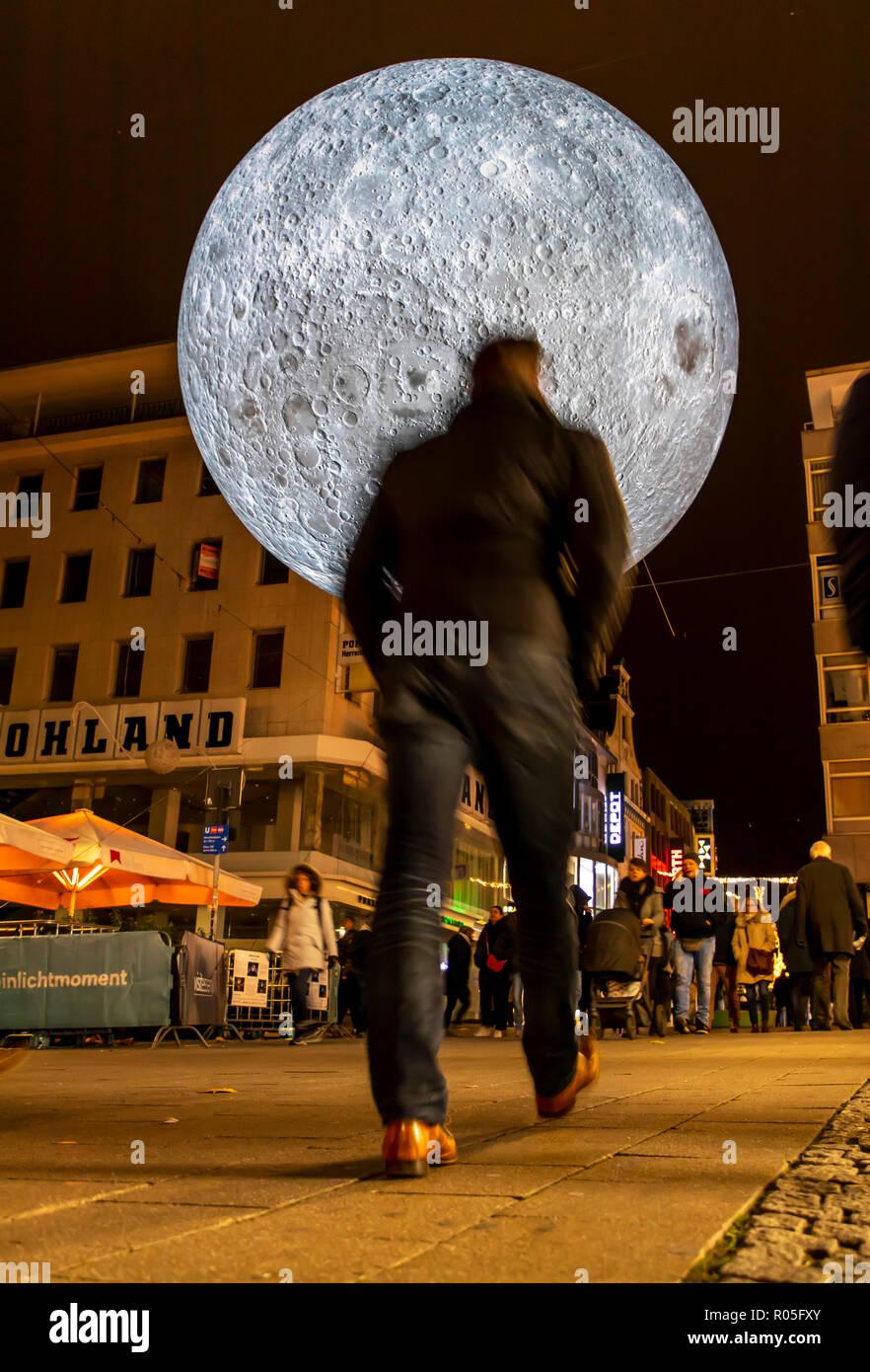 Essen Light Festival, light art installations in downtown Essen, Museum of the Moon, big shining moon, made from NASA photos, Kettwiger street, shoppi - Stock Image