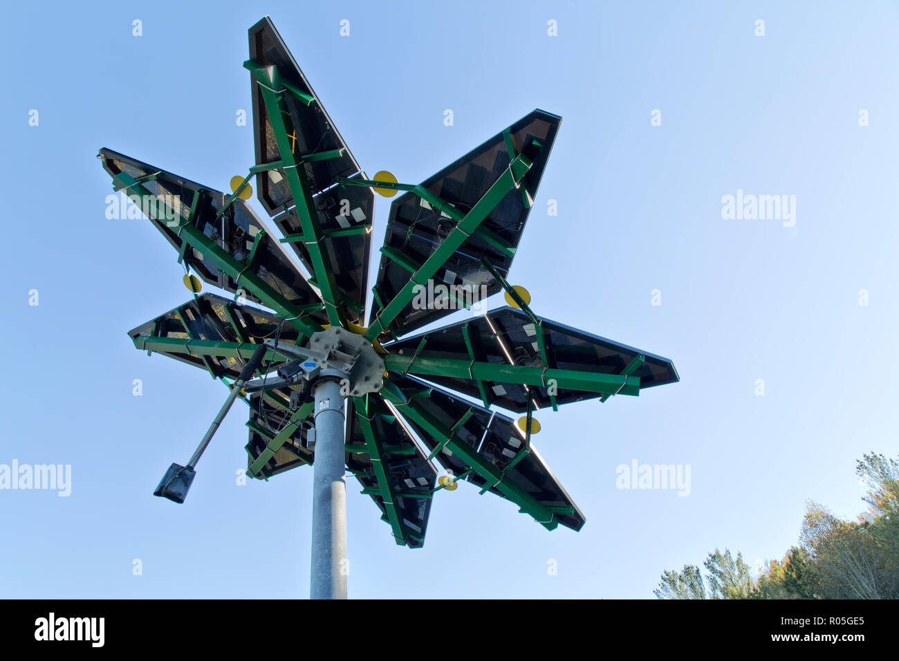 Solar Array, identified as 'Solar Photovoltaic Flair'  measuring 17 ft. diameter, weighing approx. 1200 lbs., Electric Vehicle Charge Station. Stock Photo