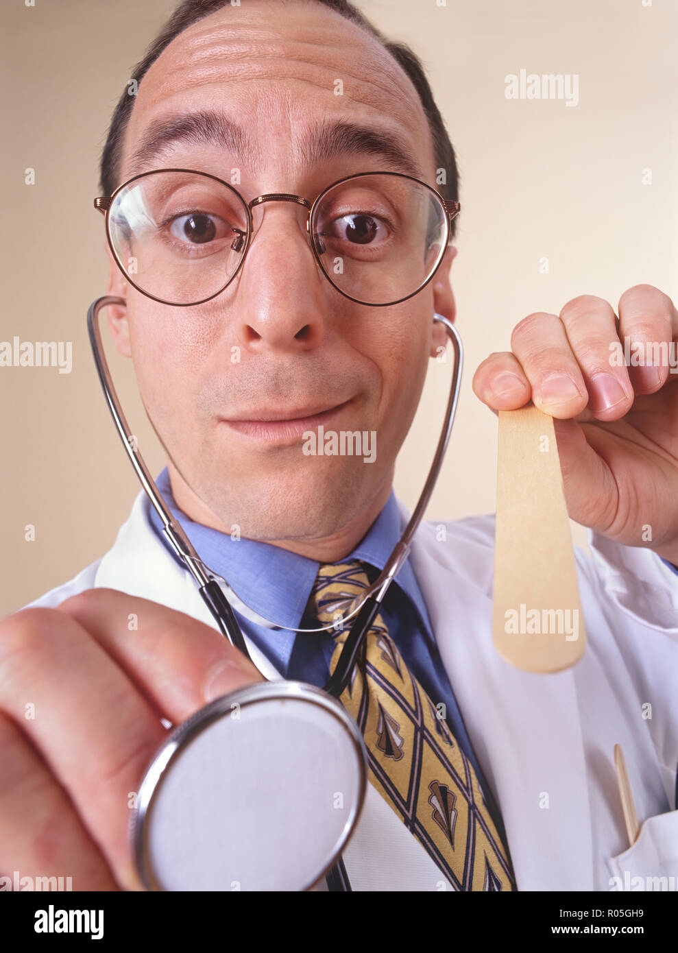 A doctors visit from a patient's personal perspective or view and doctor looking into patients mouth - Stock Image