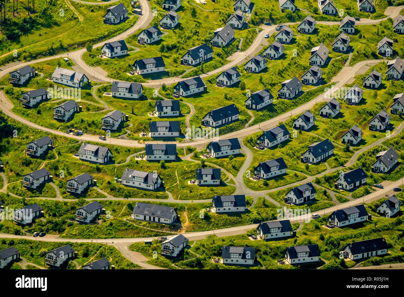 Aerial view, Holiday cottages Landal Winterberg, Apartments, Boredom, uniformity, standard construction, monotony, hilltop with standard houses, circu - Stock Image