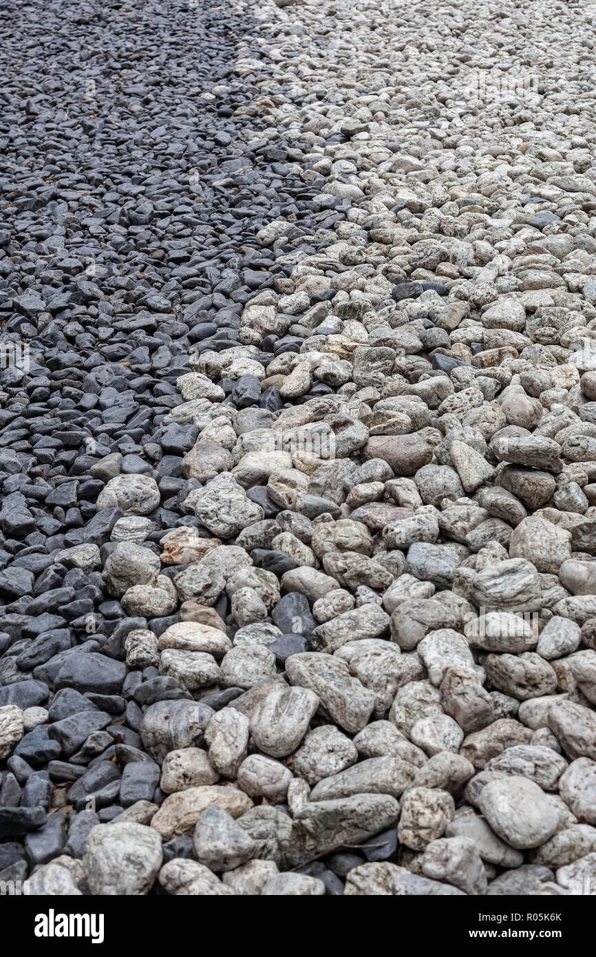 Grey and white pebbles in a Japanese zen style garden design Stock Photo