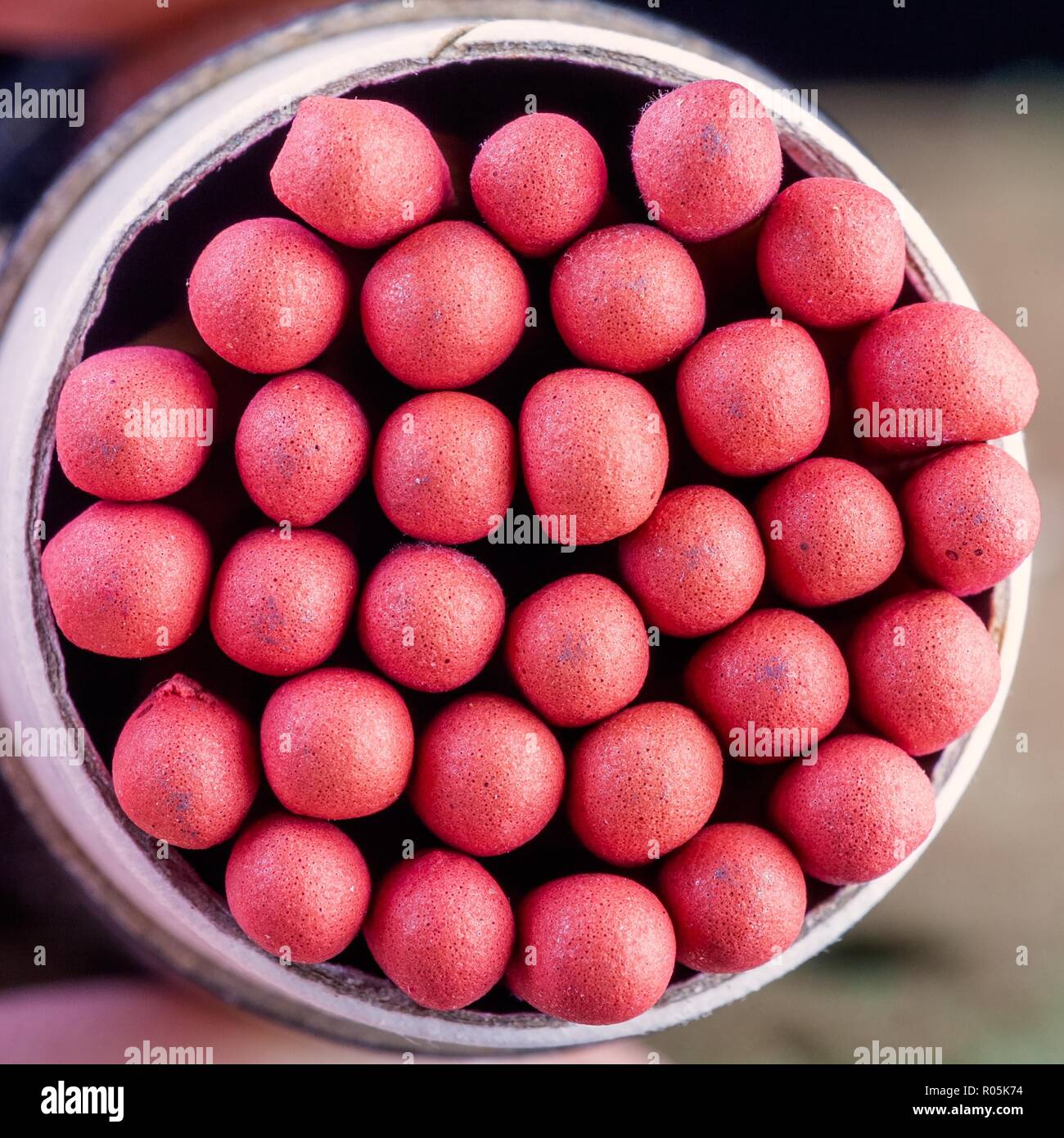 Long stem matches in a round cylindrical box - Stock Image