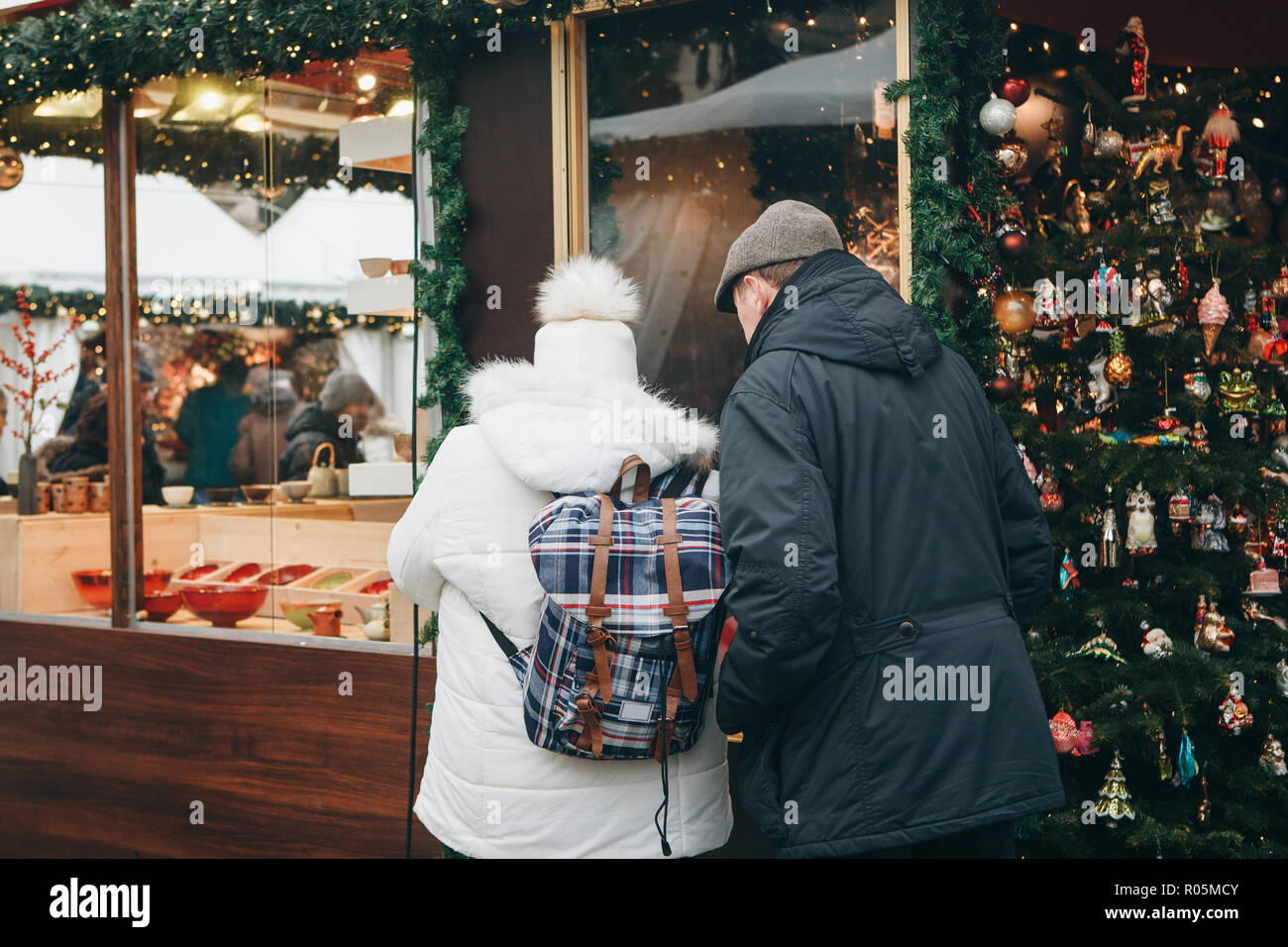 People choose Christmas gifts at the traditional decorated Christmas ...