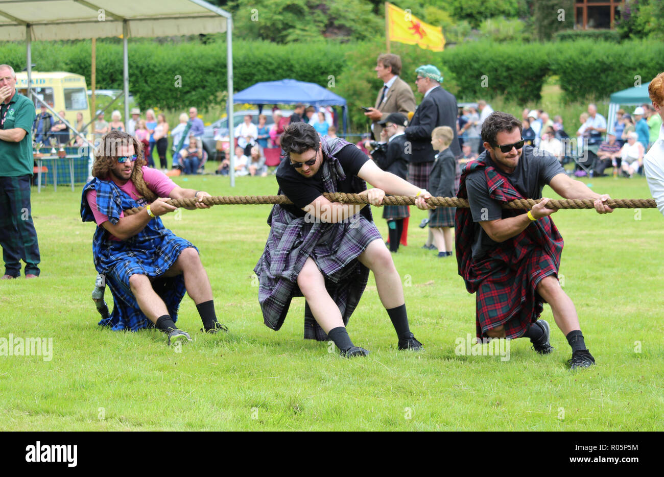 CRIEFF, SCOTLAND, 21 JULY 2018: Members of the public take part in the 'Tug of War' event at the Lochearnhead Highland Games near Crieff in Scotland.  - Stock Image