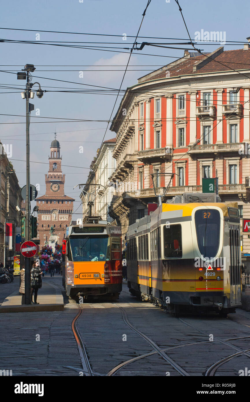 Italy, Milan, tram on Goldsmiths, in the background the Filarete tower of the Castello Sforzesco - Stock Image